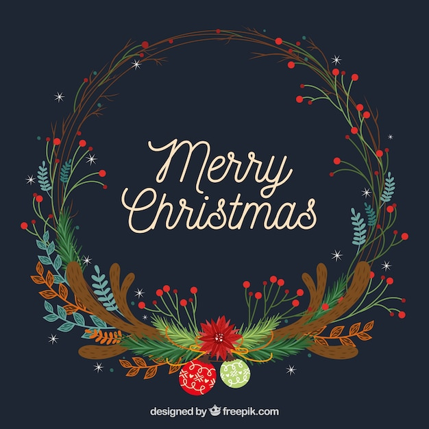 Dark blue christmas background with a colourful wreath