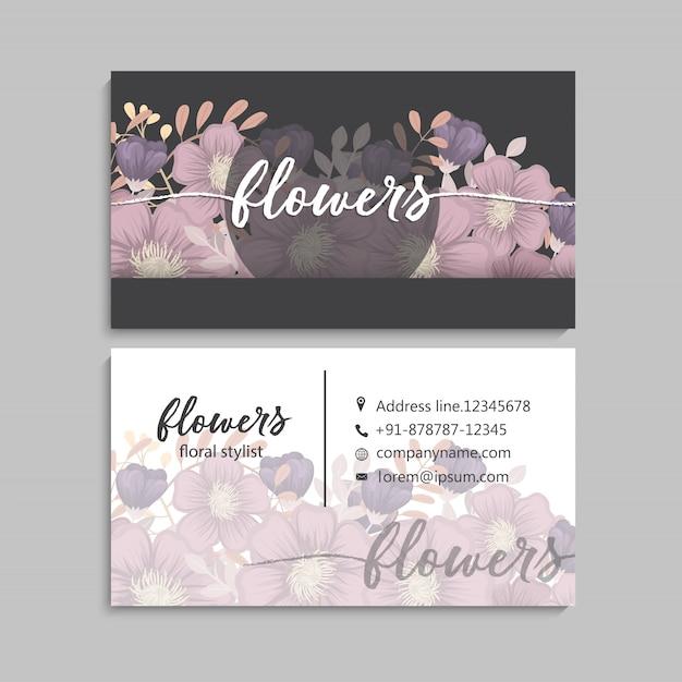 Dark business card with beautiful flowers. Premium Vector