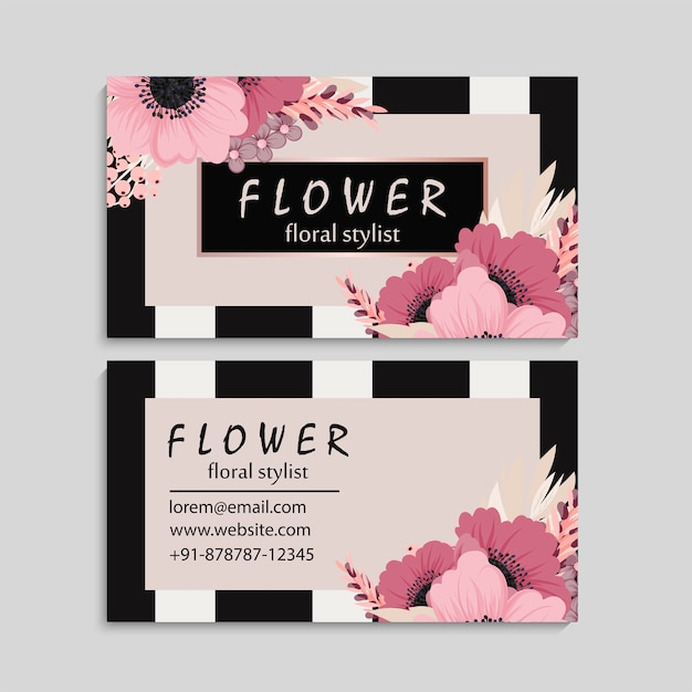 Dark business card with beautiful pink flowers Premium Vector