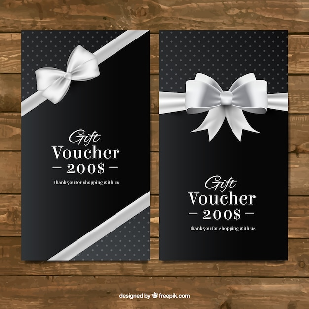 Dark gift coupons with a silver bow Free Vector