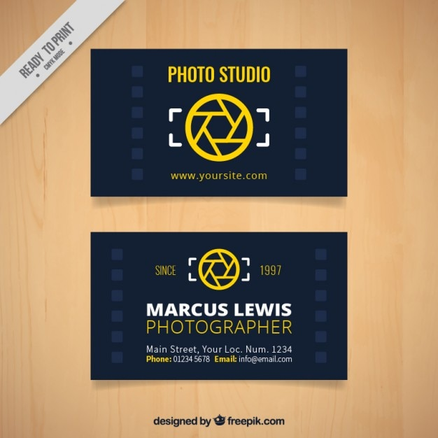 Dark photo studio card with a diaphragm