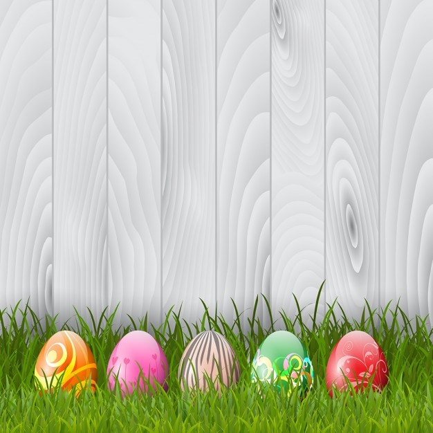 Http Www Freepik Com Free Vector Decorative Easter Eggs In Grass On A Wood Background 846414 Htm