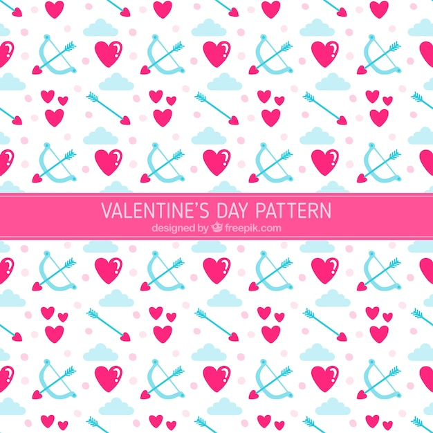 Decorative pattern of hearts and arrows Free Vector