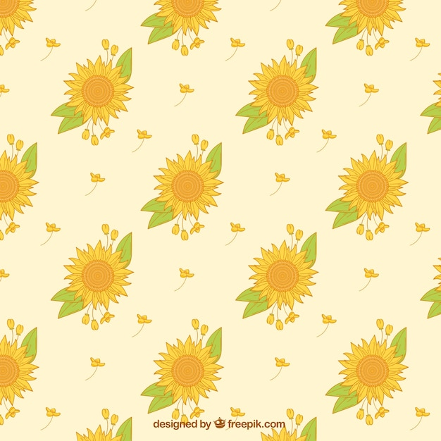 Decorative pattern of sunflowers and hand drawn leaves Free Vector