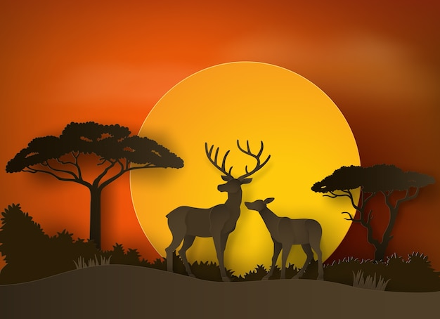 Deer in forest with sunset . paper art and craft style. Premium Vector