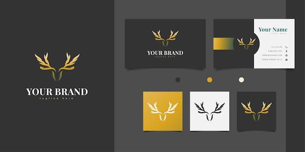 エレガントなゴールドカラーで翼を形成する枝角を持つ鹿の頭のロゴデザイン Premiumベクター