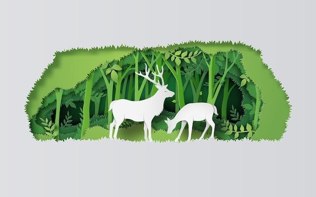 Олень в лесу. бумажный художественный стиль. Premium векторы