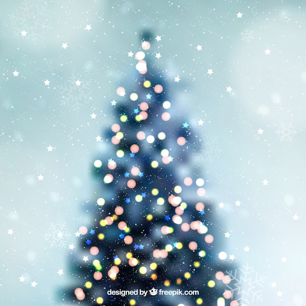 Defocused christmas tree background vector free download defocused christmas tree background free vector voltagebd