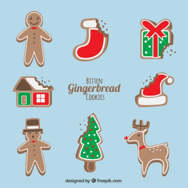 Delicious christmas gingerbread cookies with a bite Free Vector