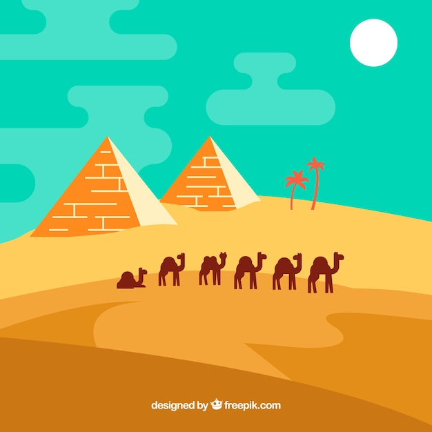 Desert landscape with pyramids and\ caravan
