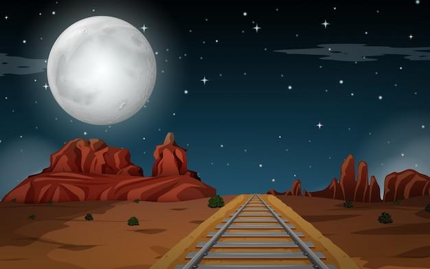 Desert scene at night Free Vector