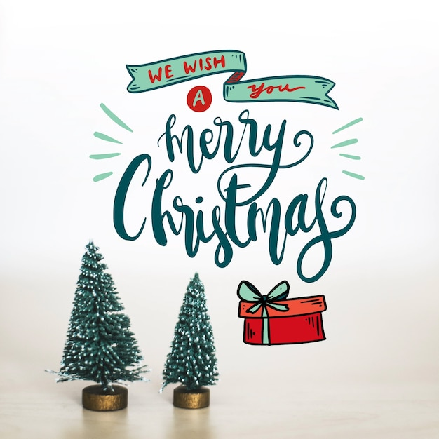 Design for merry christmas lettering Free Vector