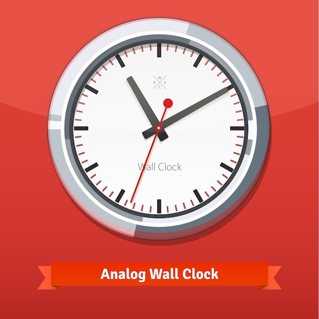Designer wall clock in a metal casing Free Vector