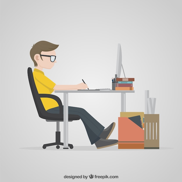 Designer working on his computer Free Vector