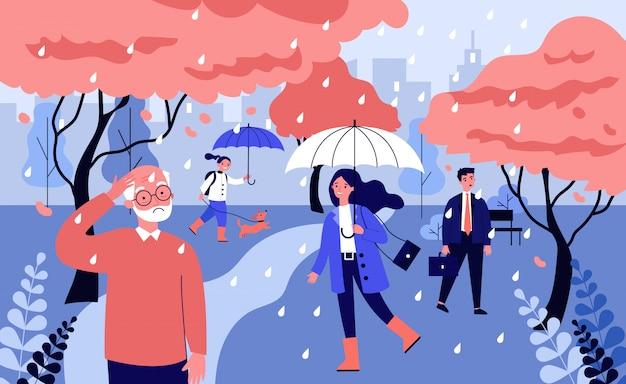Разные люди гуляют под дождем Premium векторы