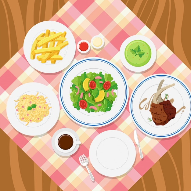 Different plates of food on table Premium Vector