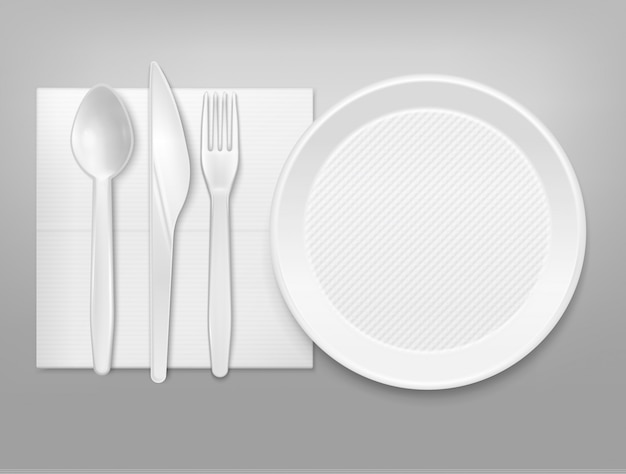 Disposable white plastic plate cutlery knife fork spoon on napkin top view realistic tableware set illustration Free Vector