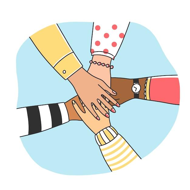 Разнообразные женщины, соединяющие их руки Premium векторы