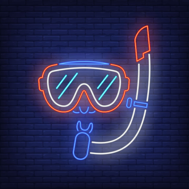 Diving mask neon sign. snorkel and glasses on brick wall Free Vector
