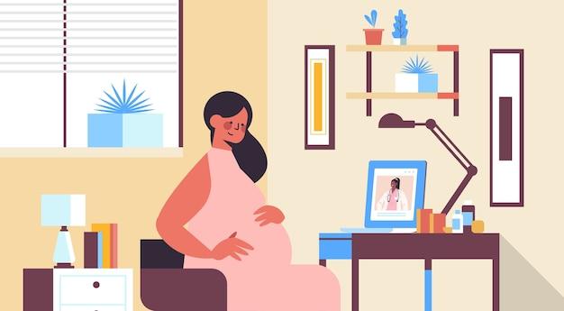 ノートパソコンの画面の医師の妊娠中の患者のオンライン婦人科相談ヘルスケアサービス医学概念リビングルームインテリア水平肖像をコンサルティング Premiumベクター