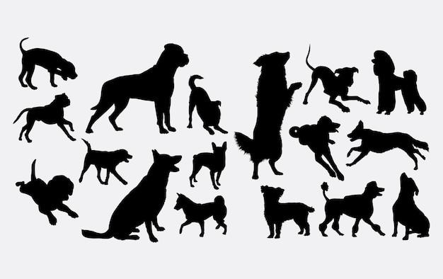 Dog action silhouette Premium Vector