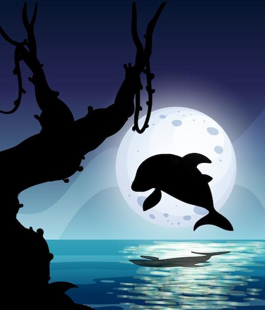 夜に海に飛び込むイルカのシルエテ 無料ベクター