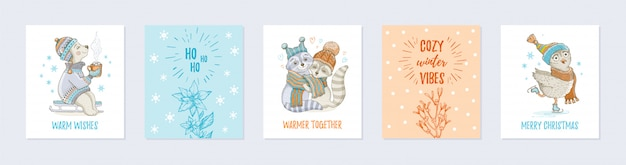 Doodle christmas greeting card set with cute animals Premium Vector