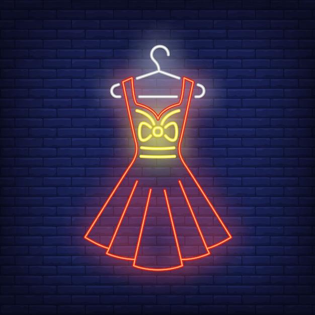 Dress on hanger neon sign. Free Vector