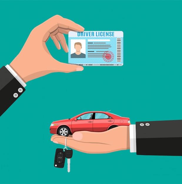 手で運転免許証とキー付きセダン車 Premiumベクター