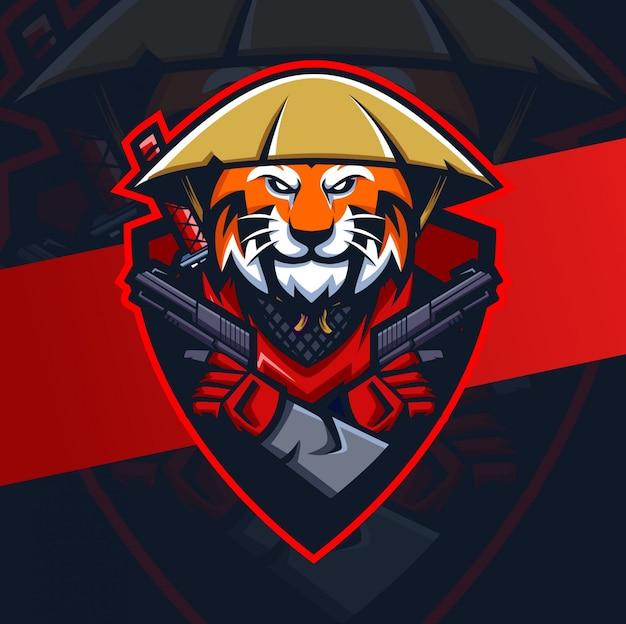 タイガーロニンと銃のマスコットeスポーツのロゴ Premiumベクター