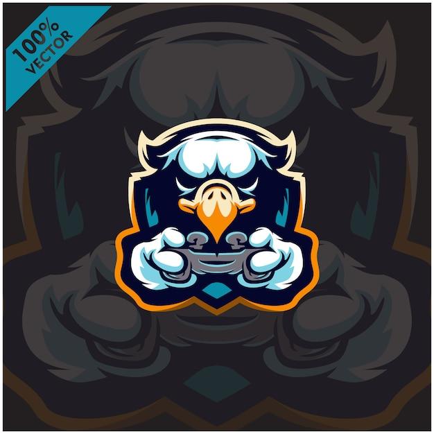 イーグルゲーマーがゲームコンソールのジョイスティックを保持しています。 eスポーツチームのマスコットロゴデザイン。 Premiumベクター