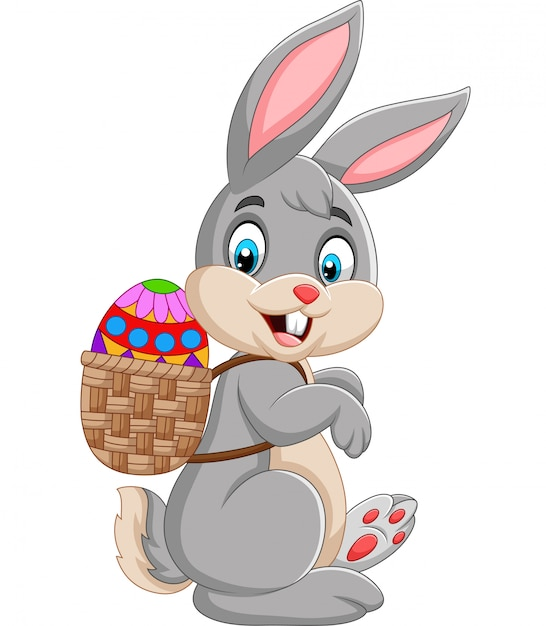Premium Vector | Easter bunny carrying basket of easter egg