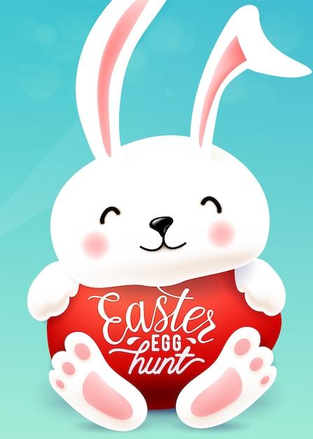 Il coniglietto di pasqua abbraccia l'uovo con la citazione di tipografia dell'iscrizione di saluto di festa. Vettore gratuito