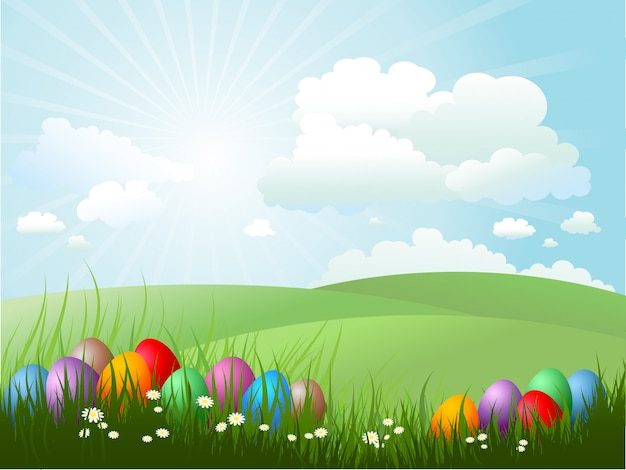 Easter eggs in grass on a sunny day Free Vector