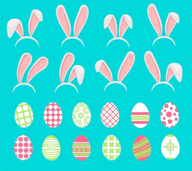 Пасхальные яйца с ушами зайца на белом фоне. Premium векторы