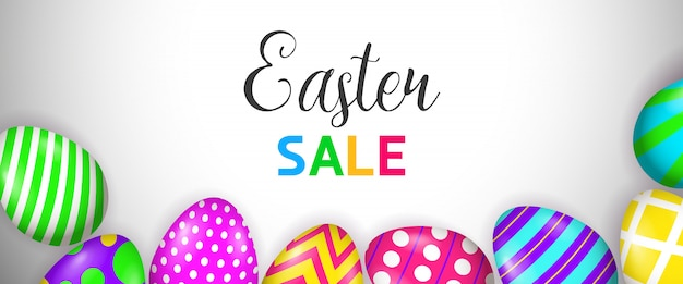 Easter sale lettering and bright painted eggs Free Vector