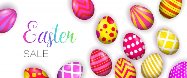 Easter sale lettering with bright decorated eggs Free Vector