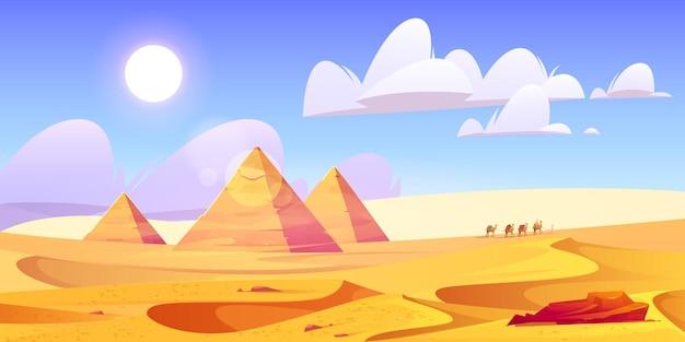 ピラミッドとラクダのキャラバンとエジプトの砂漠の風景 無料ベクター