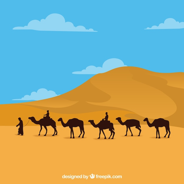 Egypt landscape with pyramids and caravan Free Vector
