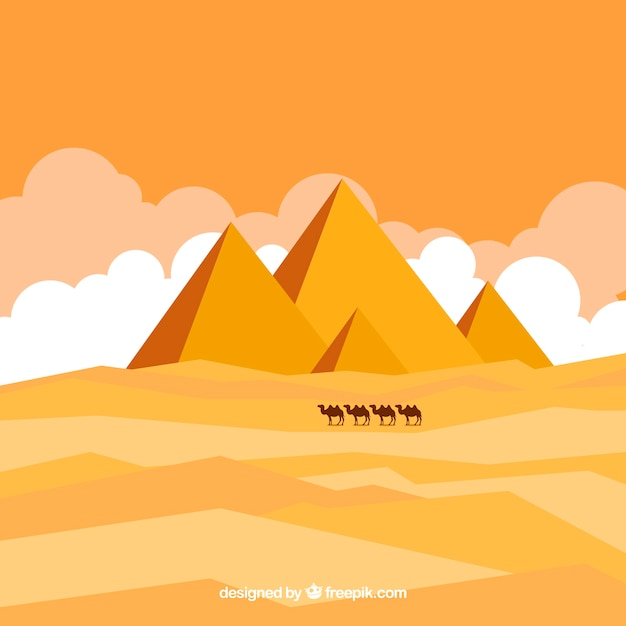 Egyptian desert landscape with pyramids and\ caravan