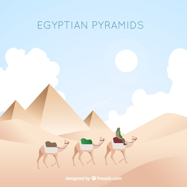 Egyptian pyramids landscape with caravan of\ camels