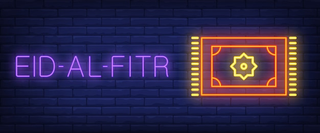 Eid-al-Fitr neon sign. Glowing bar lettering\ and prayer carpet
