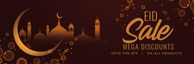 Eid festival sale banner with moon and mosque Free Vector