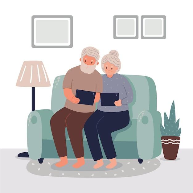 Elder couple using digital tables Free Vector