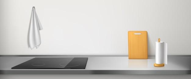 Электрическая плита на кухонной столешнице с тряпкой, бумажным полотенцем и разделочной доской Бесплатные векторы
