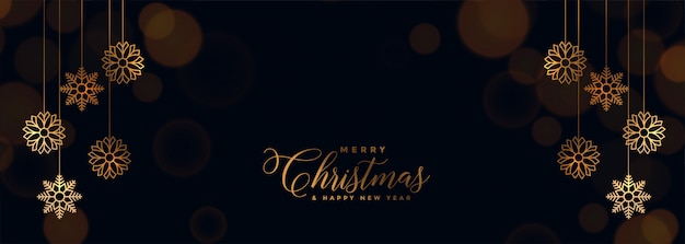 Elegant black christmas banner with golden snowflakes Free Vector