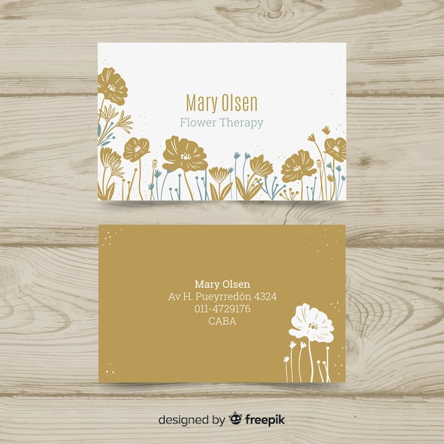 Elegant business card template with floral style Free Vector