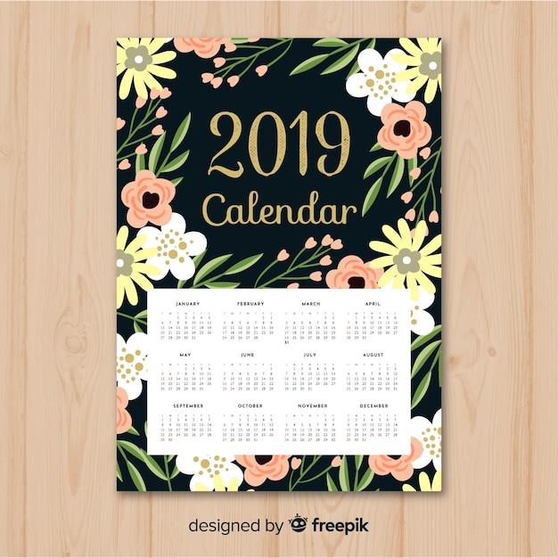 Elegant floral 2019 calendar with flat design Free Vector