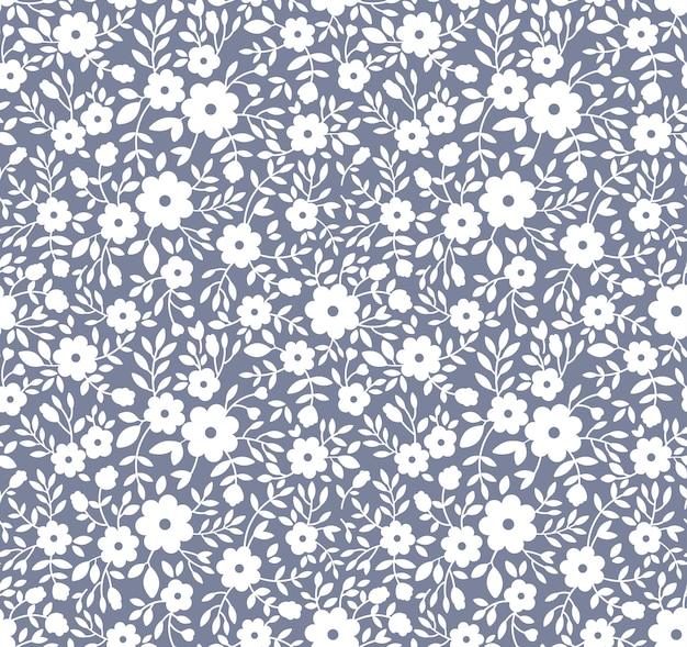Элегантный цветочный узор в мелких белых цветках. бесшовный фон для модной печати. Premium векторы