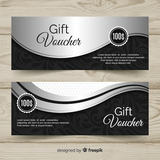Elegant gift voucher template with silver style Free Vector